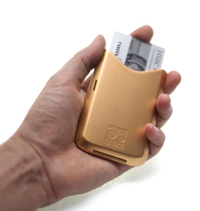 Gold Obtainum Wallet with a credit card being inserted
