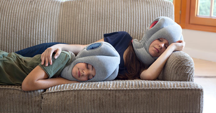 Two kids sleeping using the Ostrich Pillow by Studio Banana Things and kawamura-ganjavian