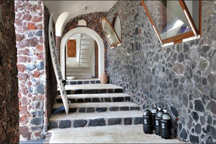 Hallway with stone walls at Perivolas Hideaway in Thirassia, Santorini
