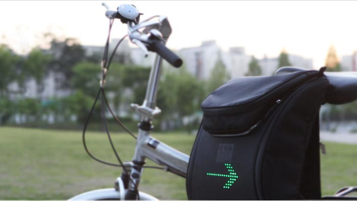 Bicycle equipped with the SEIL Bag - An LED Backpack