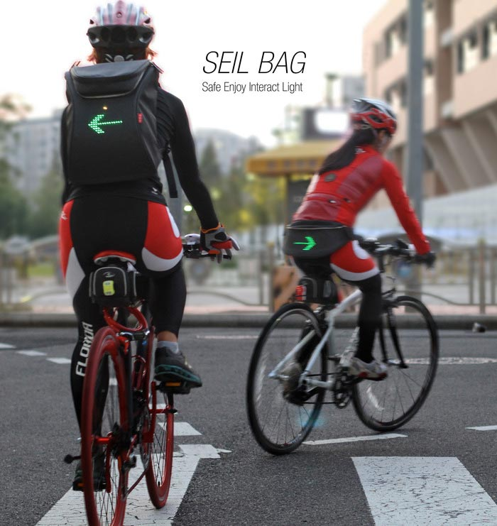 Cyclists using the SEIL Bag LED backpack