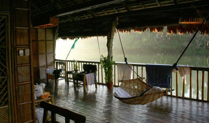 Tables and hammocks at the Villa Escudero Resort Waterfall Restaurant in the Philippines