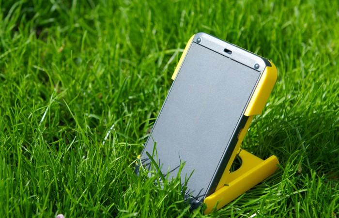 WakaWaka POWER Solar LED Lamp and Smartphone Charger outside being charged by the sun