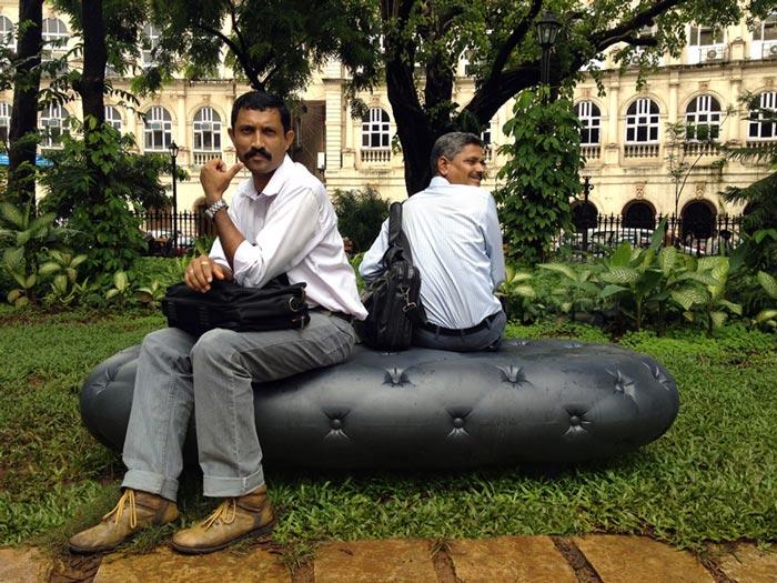 2 men sitting on the Water Bench in Mumbai