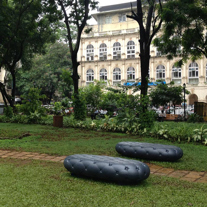 2 Black Water Benches in a park in Mumbai