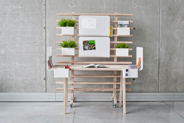 Plants organized on the WorkNest Desk - A Customizable Desk