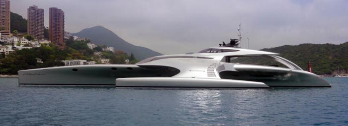 Side of the Adastra Superyacht - A Trimaran by John Shuttleworth