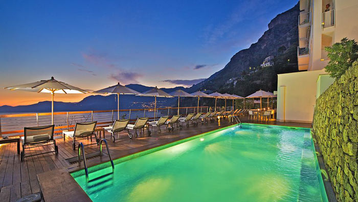 Swimming pool and scenery of the sea and mountains at Casa Angelina