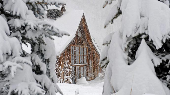 A lodge covered in snow at Dunton Hot Springs Resort