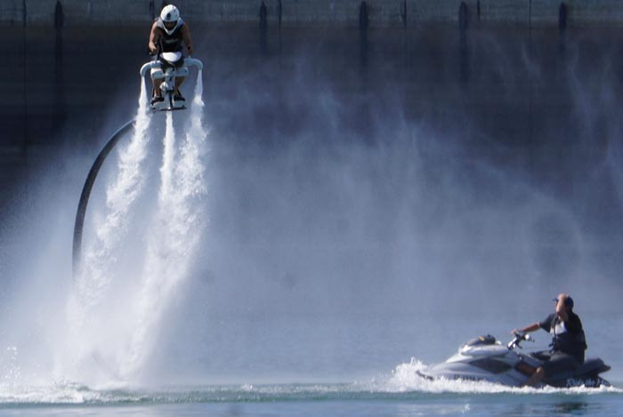 Man using the Jetovator Flying Water-Propelled Bike with a sea-doo