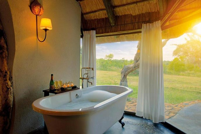 Indoor bathtub with a view at Leopard Hills