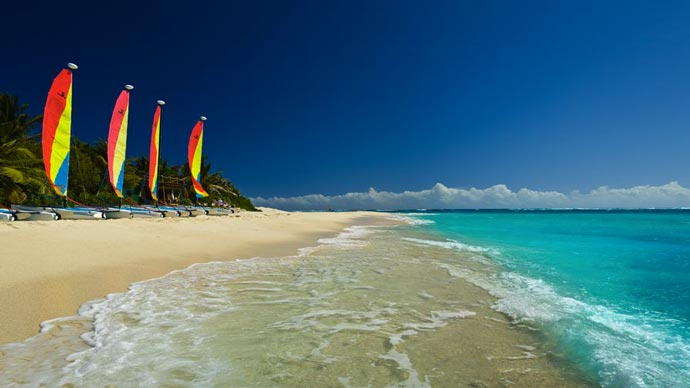 Hobie Cats lined up on the beach at Necker Island