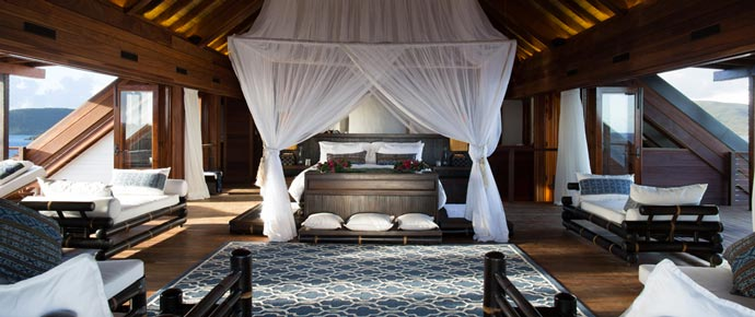 Bed in a bedroom at Necker Island
