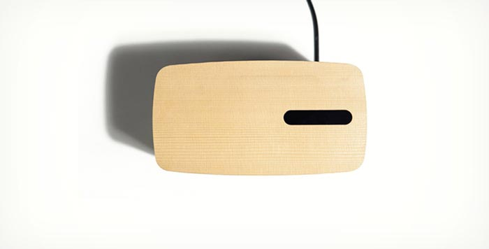 Top view of the wooden surface of the PACO Concrete Bluetooth Speaker - A Gestured Controlled Speaker