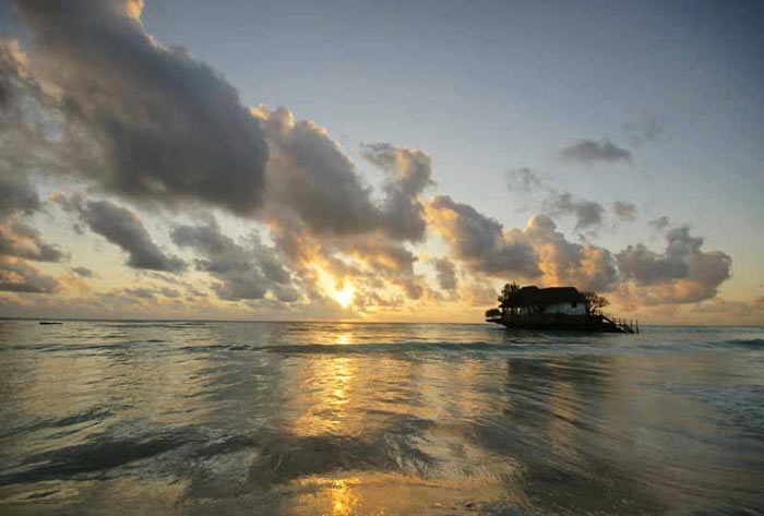 The Rock Restaurant in Zanzibar, during a sunset