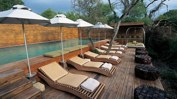 Swimming pool and lounge chairs at Singita Sweni Lodge in South Africa
