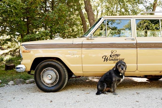 Dog near old Jeep Cherokee