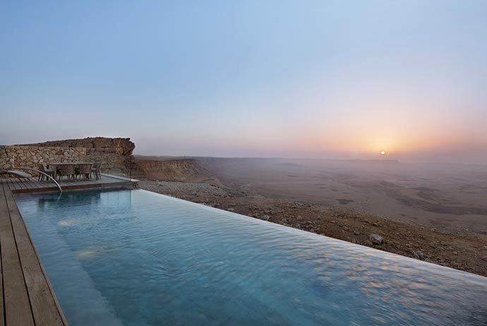 Infinity pool with a view of the desert and mountains at Beresheet Hotel in Israel