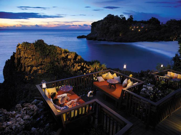 Tables on a patio with a view of the scenery at Shangri-La's Boracay Resort and Spa