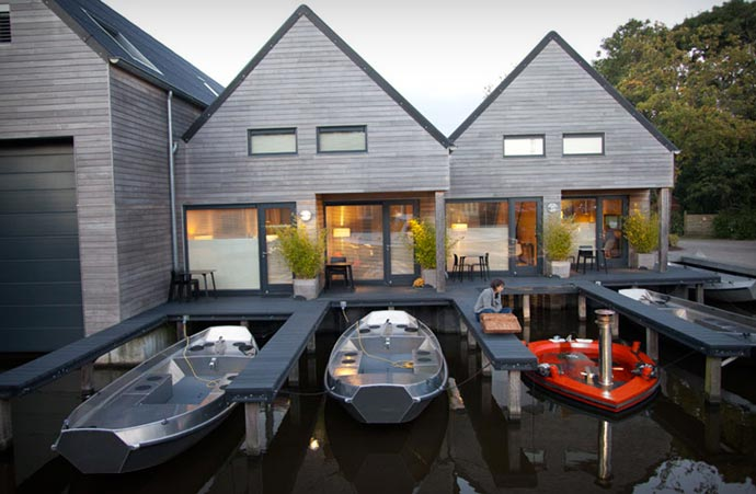 Hot Tub Boat docked in front of a house
