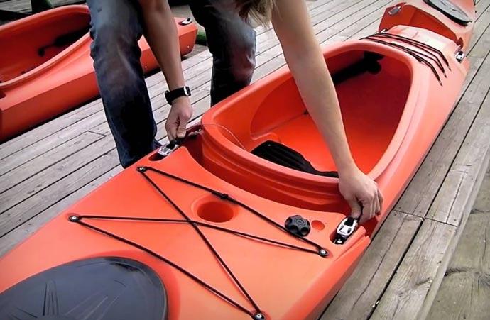 Modular kayak being disassembled