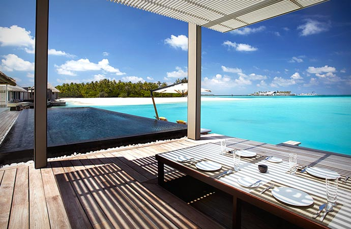 Dining by the sea at Cheval Blanc resort in the Maldives