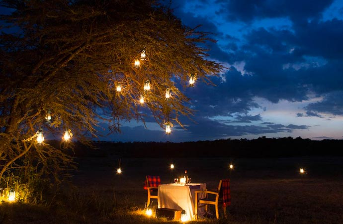 Outdoor dining at a safari camp in Kenya