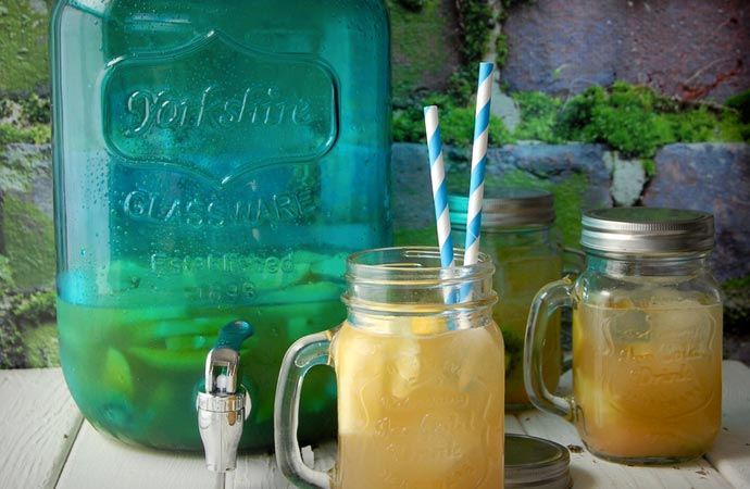 Mason jar lemonade dispenser with Mason jar glasses