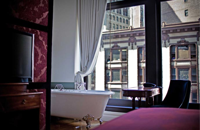 Bath tub in room at Nomad Hotel