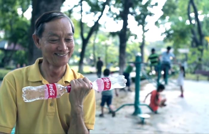 Coca-cola bottle being used for exercising