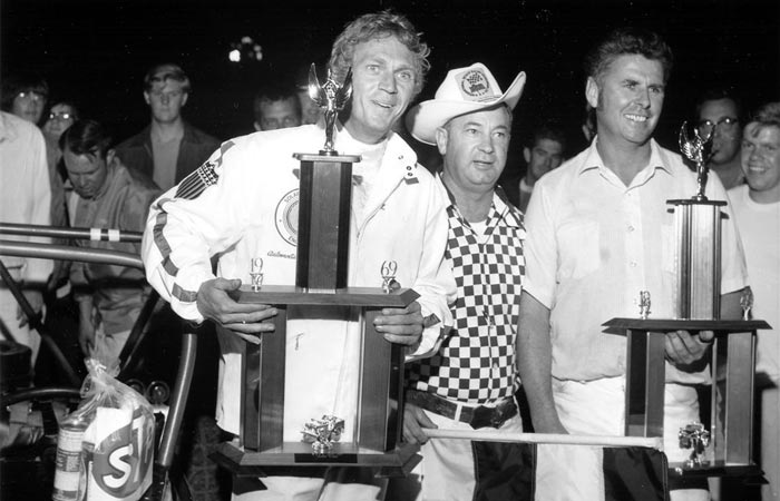 Steve Mcqueen after a race with a trophy