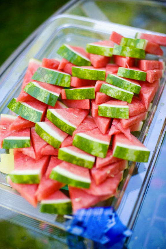 Triangle pieces of a watermelon served on a plate