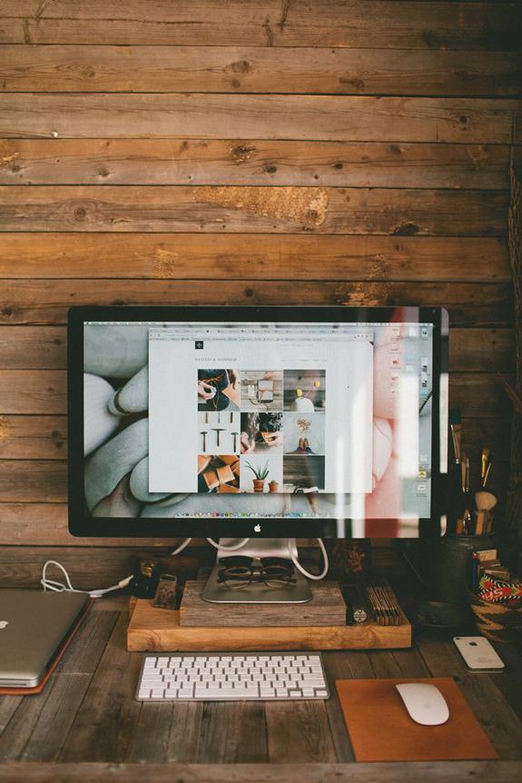 Apple desktop computer in a wooden interior