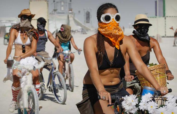People riding bikes at the Burning Man Festival