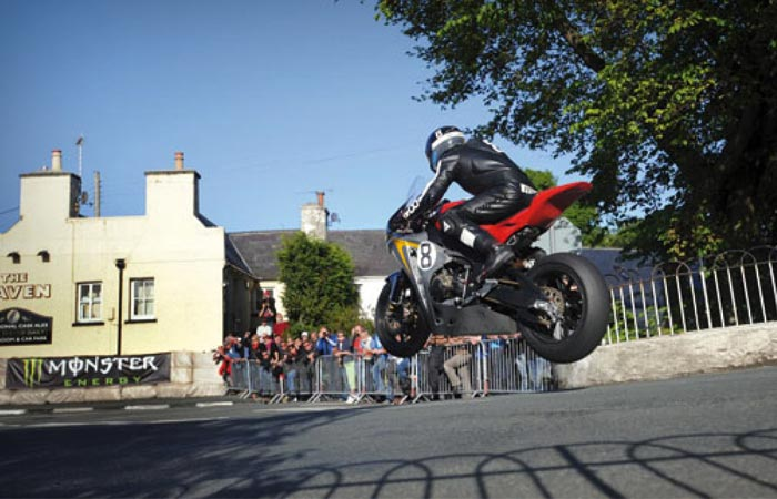 Isle of Man TT modern racer mid air