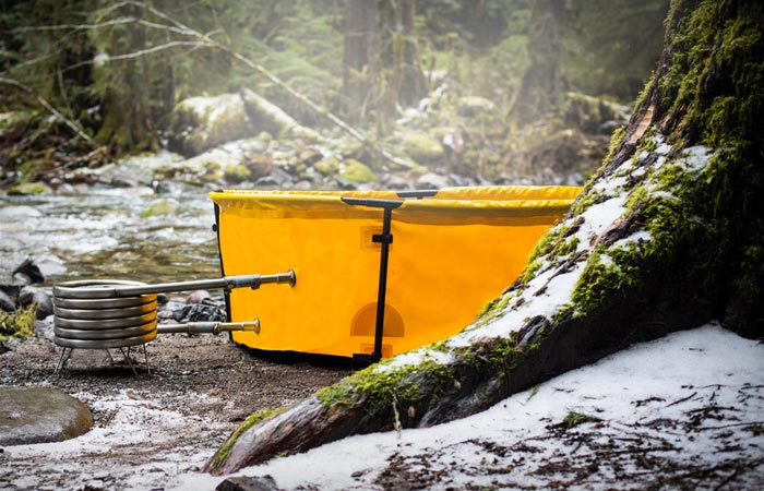 Nomad collapsible hot tub heated by firewood, propane or coal