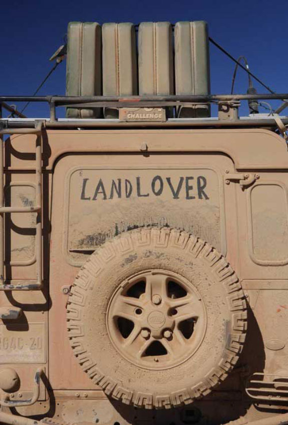 Land Lover title on a dirty Jeep