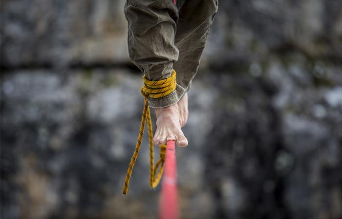 Men walking on a tight rope at the Slackline Festival