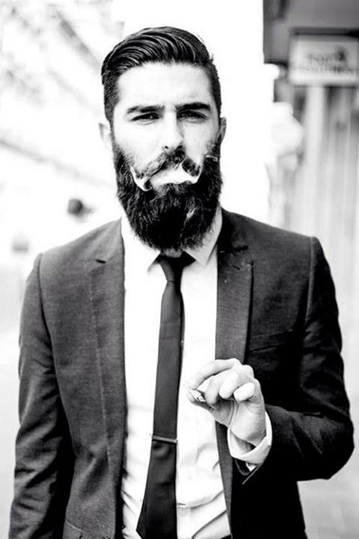 black and white photo beard guy in suit