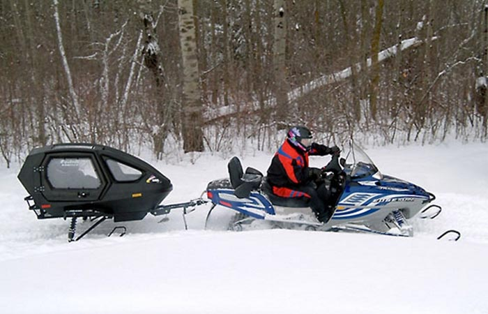 Equinox 685 Snowcoach pulled by a snowmobile