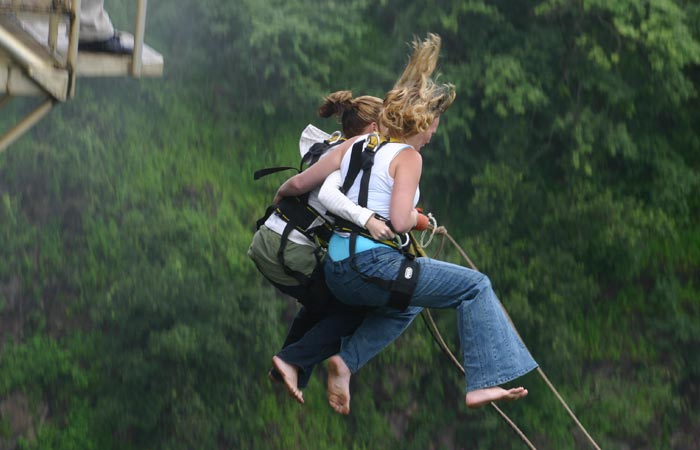 A pair of people bungee jumping together off Victoria Falls