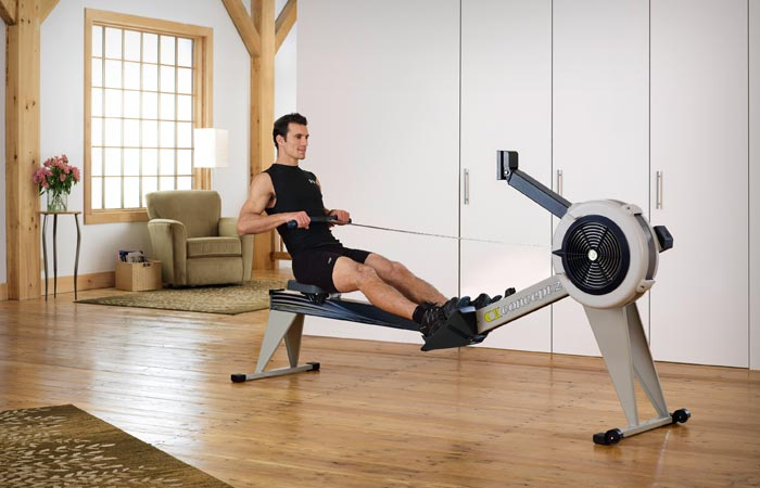 man working out on a rowing machine