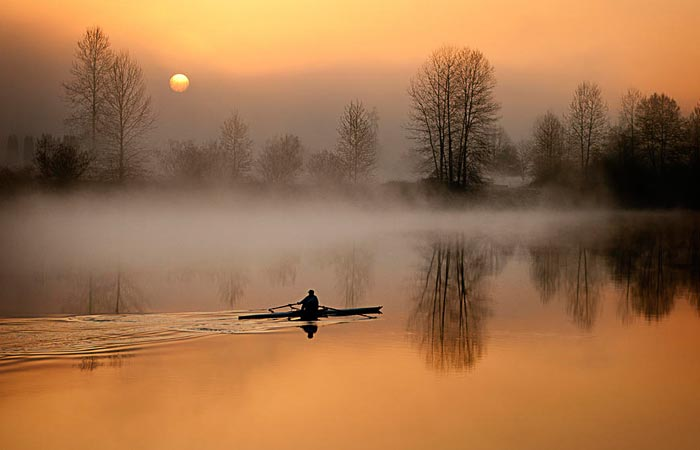 Man rowing on a lake