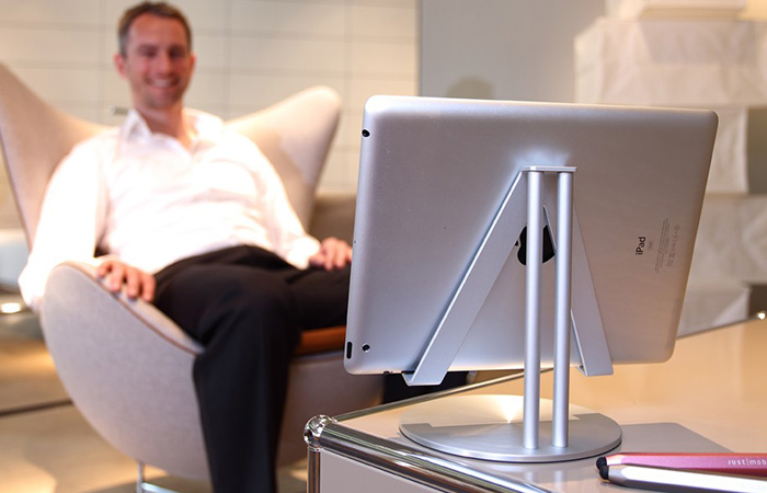 Man watching video on iPad with UpStand