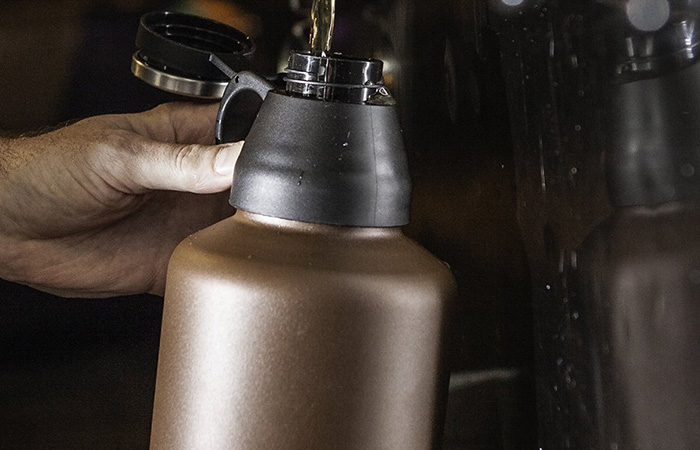 Mira beer growler being filled up