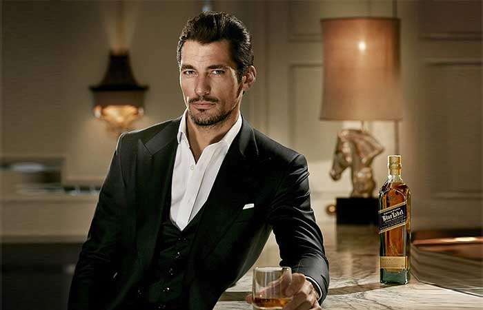 A gentleman with a glass of whiskey
