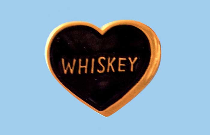 A heart with whiskey written in it