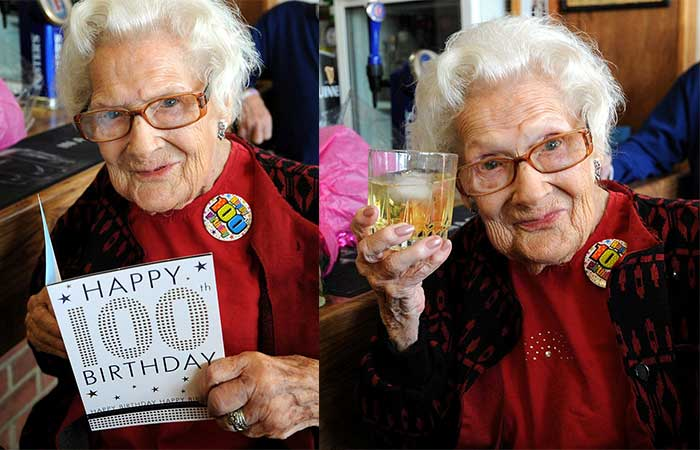 Old lady celebrating her 100th birthday with whiskey