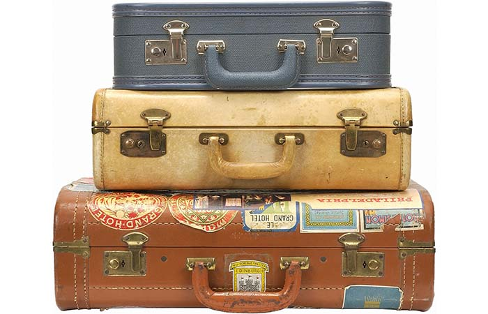 3 Vintage Suitcases With Stickers On Them