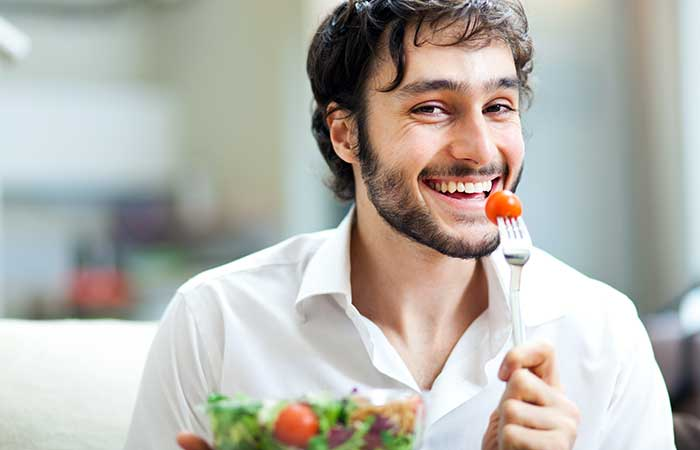 Happy man eating vegan food